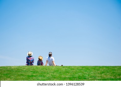 Family sitting in the meadow