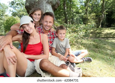 Family sitting in nature on a hiking day