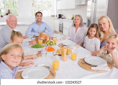 Family sitting for thanksgiving dinner