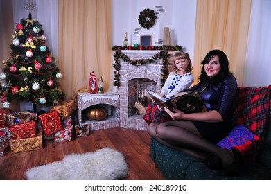 Family sitting together in Christmas interior. Happy family having fun with Christmas presents