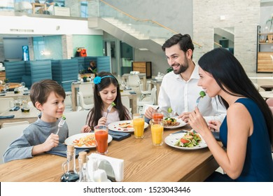 Family Sitting Together in the Restaurant Lunch Concept