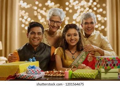 Family sitting together and Smiling with gifts on the occasion of Diwali