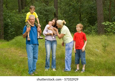 Family of six walking in thw park