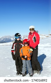 Family skiers in winter mountains
