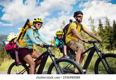 Family with small children cycling outdoors in summer nature, High Tatras in Slovakia. - Shutterstock ID 1936980088