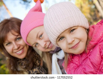 Family with small girl in front at autumn