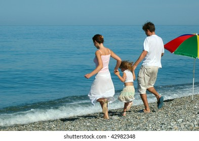 Family with small girl go on seaside