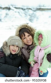 family smiling against the backdrop of the snow background
