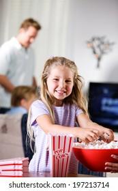 Family: Smiling Girl At Family Movie Night