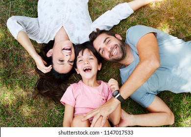 Family smiling together in park