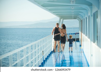 family with son walking on cruise liner deck, full body