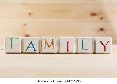 FAMILY spelled in wooden blocks