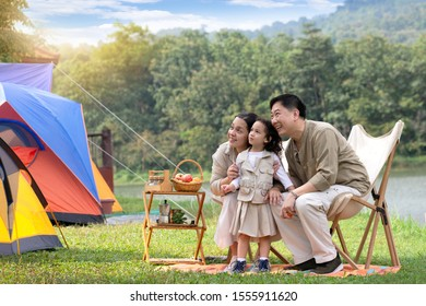 Family spend good time together on holidays in the countryside, in camping area near lake