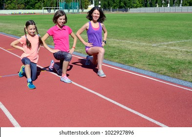Family sport and fitness, happy mother and kids exercising and running on stadium track outdoors, children healthy active lifestyle concept