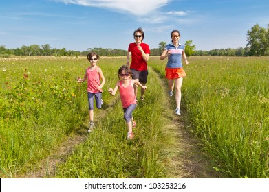 Family sport, jogging outdoors. Happy active parents with kids run. Healthy family lifestyle concept