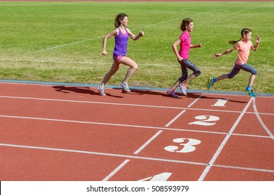 Family sport, mother and kids running on stadium track, training and children fitness concept