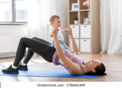 family, sport and motherhood concept - mother with little baby exercising at home