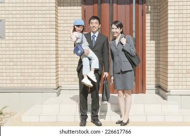 Family standing in front of the front door