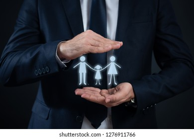 family standing holding hands in man's hand.Family protection concept.
