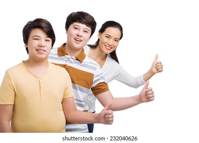 Family standing in a row and showing thumbs up