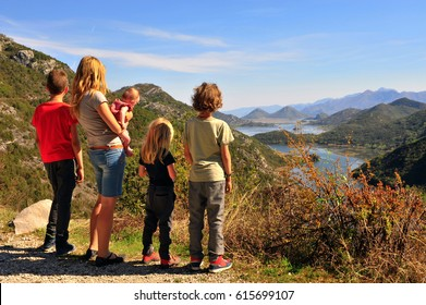 Family standing at viewpoint of Rieka Crnojevica, Montenegro.