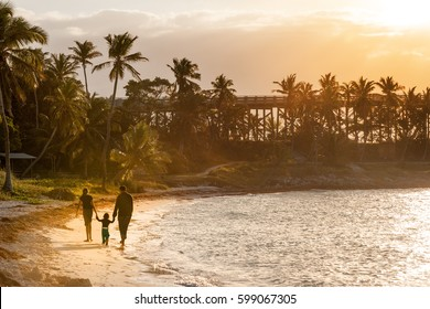 Family strolling on sandy beach of Bahia Honda state park in Florida Keys