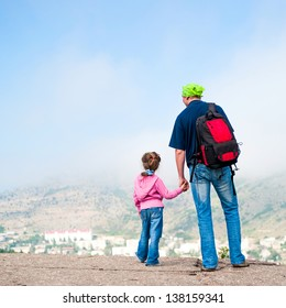 Family summer vacation in mountains. Active happy dad with daughter  having fun in travel