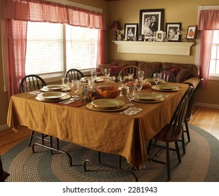 Family Table With Holiday Place Setting Waiting for a Meal