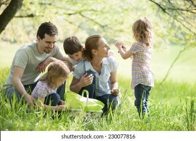 Family taking a break on a meadow