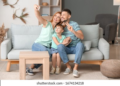 Family taking selfie at home