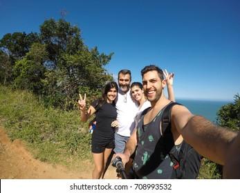 Family taking a selfie in in Ilhabela, Sao Paulo, Brazil