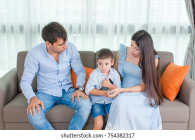 Family talk in the sitting living room and use Mobile