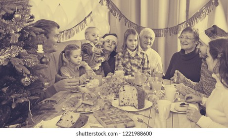 Family are talking to each other during Christmas dinner