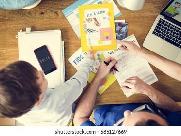 Family Teaching Son Homeschooling Technology
