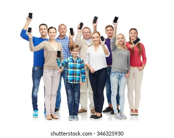 family, technology, generation and people concept - group of smiling men, women and boy smartphones