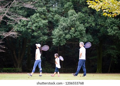 Family with tennis racket
