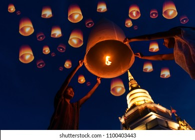 Family - Thai people floating lamp in Yeepeng festival