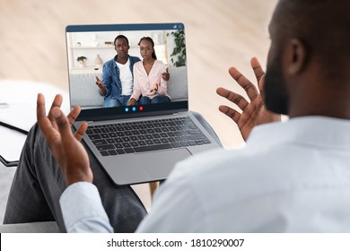 Family Therapist Consulting Black Young Couple Online Via Laptop, Selective Focus