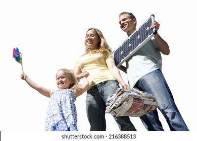 Family of three, girl with pinwheel, father with solar panel, mother with bundle of newspapers, cut out