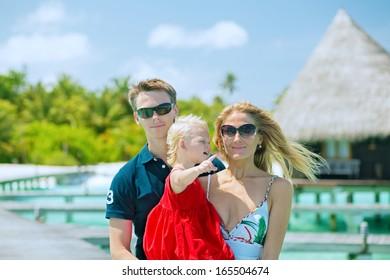 Family of three having tropical vacation on Maldives