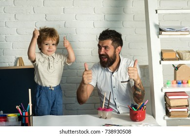 Family thumbs up. Father and little cute son show thumbs up, success on home education. Good hand, good job, show thump up for agreement sign success business art concept. Children learning success