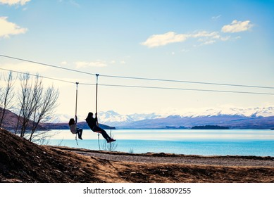 A family time by playing a zip-line  over the lake Tekapo ,NewZealand.
