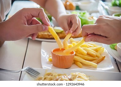 Family time eat French fries together - family life with food concept