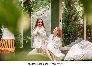 Family time, spa and beauty, mothers day. mom and daughter in beautiful spa with big garden view window. Kids hygiene.