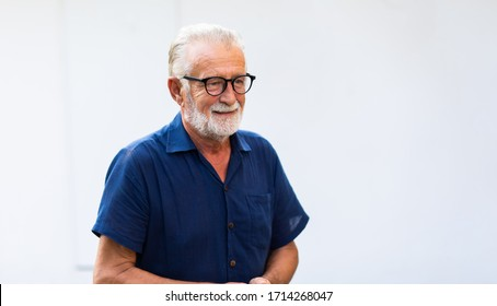 family time together at home concept. lifestyle. Portrait of happy and handsome bearded senior man in glasses enjoy nature garden at home. Elder man
