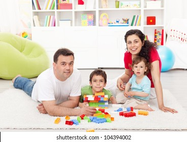 Family time - young parents with two kids playing together at home