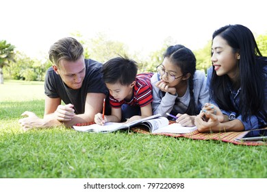 Family Time,The parent son and Daughter spend time together on weekend. Father With Children Having Fun In Park. Happy Smiling Parent Playing With  Kids In Nature. Young Family Spending Leisure Time.