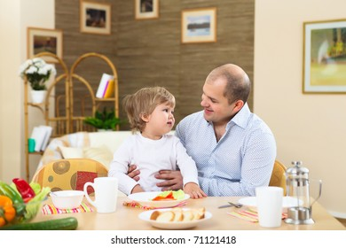 family together at home having meal with a child