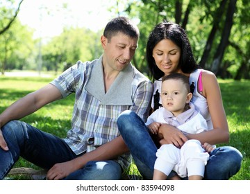 Family together in the summer park with a son