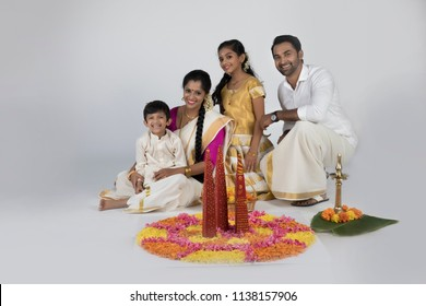 family in traditional kerala dress south indian look